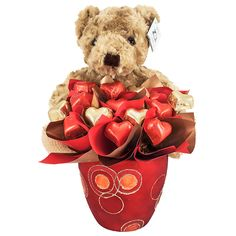 """Nothing says """"I Love You"""" quite like a cute and cuddly Teddy Bear. This huggable """"From Me to You"""" Teddy, will win your loved one's heart this Valentine's Day with this delightfully romantic surprise."""