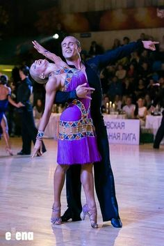 Riccardo and Yulia rumba - we love the colourful cut-outs and beading, an elegant and jazzy dress.