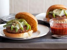 Jeff Mauro gives burgers an international twist by using Italian sausage for the patty and topping them with cooked sweet peppers and mozzarella.
