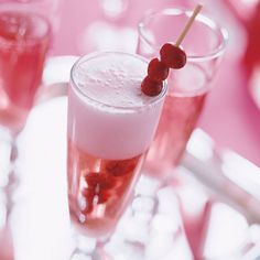 Tart fresh cranberries complement the sweet rose wine in our bubbly champagne cocktail recipe. Skewered cranberries are a cute drink garnish./