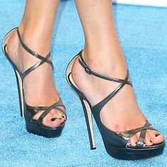 "Taylor Swift wearing her no-fail Jimmy Choo ""Suki"" sandals"