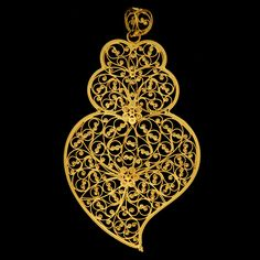 ...They first appear in Portugal due to the cult of the Sacred heart of Jesus – that is why the people enjoy using them on their chest as a sacred symbol, even with simpler forms.  They can be made in plate (hollow), in filigree or in hit and engraved plate. www.museudaourivesaria.com