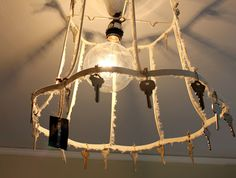 From the Bachman's 2012 Spring Ideas House...old lampshade with keys light cover