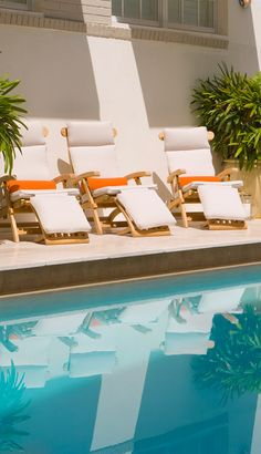You can find me by the pool in Miami! Soak up the sun on cool white loungers with bright tropical pillows and sunshades.  #DestinationTrexSweeps