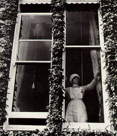 Parlourmaid at a window in Kensington, 1931-35 by Bill Brandt