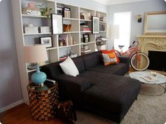 Love the use of the 4 bookcases behind the couch! Just get bookcases from walmart or target and just leave the cardboard backs off