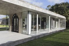 Striking concrete and glass home has a twist - Curbedclockmenumore-arrow : Does the front door ruin its style?