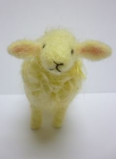 A needle felted sheep from Maisie Moo Crafts.  Aaaah...this is so cute!
