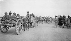MESOPOTAMIA CAMPAIGN 1914 - 1918 (Q 24353) As Turkish prisoners suffered from desert march to Baghdad, they were given a lift in A. T. carts.