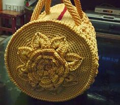 This handbag has been floating around on Pinterest and Facebook crochet groups in Holland. It's a pattern called 'Mermoz Round Bag' f...