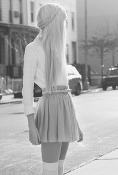 I love this photo. It gives me a 70's flower child/school girl feel with the long blonde hair, high waisted skirt and knee high socks.