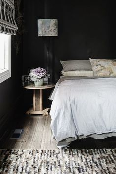 black walls and timber floors