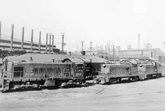 """EJ&E switchers - Elgin, Joliet & Eastern, U.S. Steel's 236-mile """"Outer Belt"""" around Chicago and the switching road for USS's huge Gary (Ind.) steel complex, began buying diesel yard goats in 1936. EMD and Alco switchers are seen inside the mill in 1947, two years before EJ&E became all-diesel.- C. P. Fox photo - from Classic Trains"""