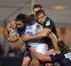 Racing Metro's Sebastien Chabal is wrapped up . The best feeling on earth to drag three players down the field #rugby #usarugby #rugbynation