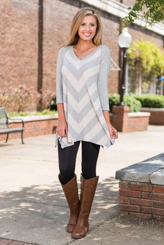 There's no way to feel down and out in something this comfy! This heather gray and white tunic is perfect for running errands, shopping or just hanging out with friends. And what girl passes up a chance to wear leggings?!