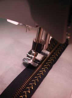 Zippers Creatively Embellished with Decorative Stitching or Machine Embroidery | seecherylsew