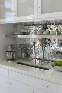 Mirrored mosaic backsplash?! Looks better with black counters