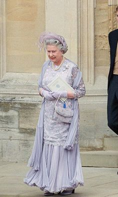 <p>Texture galore, this pale purple gown was donned for Prince Edward's wedding in 1999. <p>Photo: © Getty Images
