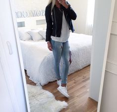 White shoes, light blue destroyed jeans, loose white shirt, leather jacket