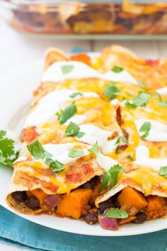 A simple recipe for vegetarian enchiladas made with sweet potato and black beans. These vegetable enchiladas are our favorite healthy enchilada recipe! Vegetable Enchiladas, Enchiladas Healthy, Breakfast Enchiladas, Vegetarian Enchiladas, Bean Enchiladas, Dog Recipes, Veggie Recipes, Healthy Dinner Recipes, Mexican Food Recipes