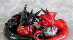 Adorable sculpted dragons guard your 20-sided dice