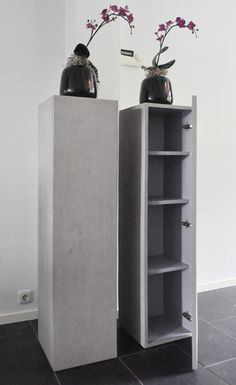 Concrete pillars with storage.