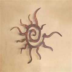 Sun tat... I have this tattooed on the back of my neck