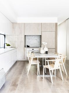 Step inside this photographer's light-filled home in Sydney's Queens Park complete with a neutral, elegant kitchen with white-washed floors, white cabinetry, and light-timber chairs. Grey Dining Tables, Dining Chairs, Dining Area, Kitchen Decor, Kitchen Design, Kitchen Ideas, White Washed Floors, Timber Table, Cheap Rustic Decor
