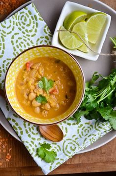 red lentil coconut soup ---> just made this for dinner. it can be made in the crock pot. and you could add chicken if you want meat.  we put it over jasmine rice and it was fabulous. don't skip the lime juice on top, it really makes it! oh, and i didnt have fresh ginger so i used ground ginger and it was fine. ps... my kids ate it too!