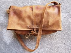 a very pretty worn leather bag