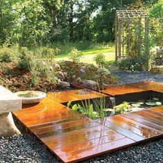 I like the idea of a pond inset into a deck, but would prefer it in a courtyard setting. It seems too harshly rectangular for a rural looking garden.