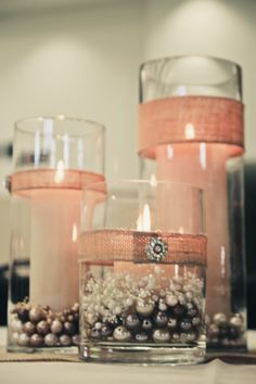 Single strip of different sized ribbon on each candle could be easy way to dress up plain glass candle holders. Maybe coral fabric with white or gray candles Wedding Table, Rustic Wedding, Our Wedding, Dream Wedding, Wedding Simple, Shabby Chic Wedding Decor, Table Centerpieces, Table Decorations, Romantic Decorations
