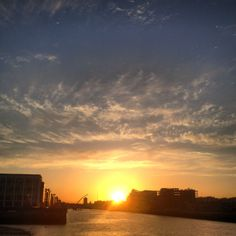 Sunset looking down the Liffey River in Dublin, Ireland. Amazing Buildings, Dublin Ireland, Irish, Sunrise, River, Celestial, Outdoor, Outdoors, Irish People