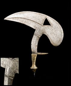 Africa | 'Musede' knife from the Kota people of Gabon | Iron blade with a wood handle covered in brass || 19th century | March 2014 Catalogue, pg 43