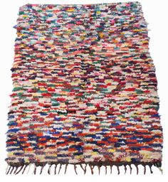 Riotously full of colour, this thick 'boucherouite' rug is woven using textile strips and displays very fine weaving -- a rainbow of hues are combined in finely woven rows  Size : 1.50M by 1m