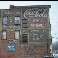 """Photo of a Coca-Cola """"ghost sign"""" painted on a building on Broadway in Schenectady, N.Y. Photo taken January 19, 2010. Photo by Chuck Miller."""
