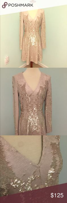 Vince Camuto sequin fit flare dress Available in 2015 from high end department stores. Worn once, still in excellent condition! White and gold sequins all over dress, sequins are pulled against the grain to show off pattern. 34.5 inch length, v neck, partially lined interior slip, 95% rayon 5% spandex  Will consider offers. Vince Camuto Dresses Midi