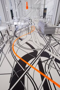 "German artist Tobias Rehberger likes to shake things up. Since stepping on the scene 15 years ago, he's turned to a variety of mediums to toy with perception, consistently challenging his audience to see the ""things which cannot be seen."" His latest work transforms the interior of a cafe in Finland's cultural capital Turku into a mind-boggling display of criss-crossing lines, an installation he conceived in collaboration with Artek. Brand Presentation, Pop Up Shops, Exploring, Strong, Branding, Traditional, Digital, Amazon, Box"