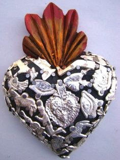 Milagros Sacred Heart from Michoacan, Mexico ... have one of these in my kitchen