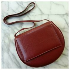 """Silence and Noise Structured Moon Crossbody Bag Beautiful brick red structured round faux leather bag. Square front flap with magnetic snap closure. Single compartment, 7"""" x 9"""" x 2"""", 19"""" strap drop. Brand new. Urban Outfitters Bags Crossbody Bags"""