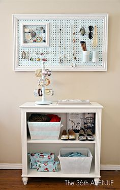 framed pegboard as jewelry holder...love the painted/paper-covered soup cans with paper doilies, painted stripes on fabric bins, mug holder for bracelets + small white frame with chicken wire for earrings