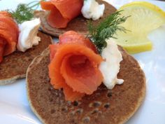 Buckwheat Blini with Smoked Salmon: In Russia, blinis are commonly topped with sour cream and pickled herring, smoked salmon, or caviar. But don't stop there. They're also delicious served with honey, maple syrup, yogurt, fruit, sautéed vegetables, meats, eggs, and/or cheese.