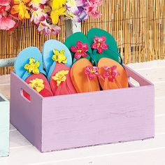 Decorate inexpensive flip-flops by attaching faux tropical flowers to the thong with hot glue. (Great summer party favors!)