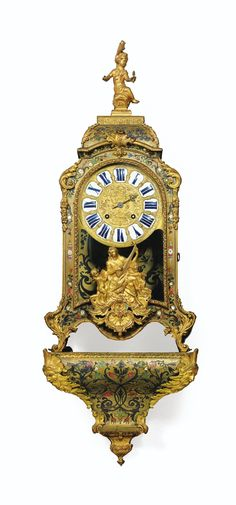 *A BOULLE MARQUETRY CARTEL CLOCK, EARLY 18TH CENTURY, THE MOVEMENT SIGNED DELORME A PARIS