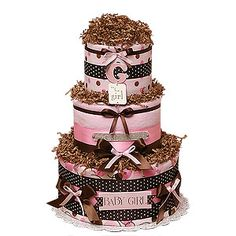 Diaper Cakes with ribbon and crinkle shred.  #babyshowerideas #diapercakes http://www.nashvillewrapscommunity.com/blog/2009/10/diaper-cakes-how-to-make-this-must-have-gift/