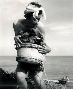 A selection of Iwase Yoshiyuki's photographs of the ama divers in Japan, a majority of whom are women and plunge as deep as 80 feet into the sea to collect pearls, abalone and prized coral.