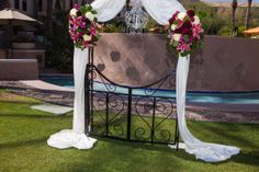 Lovely flowers by Tansy Floral Design! Romantic arch decor for sure!