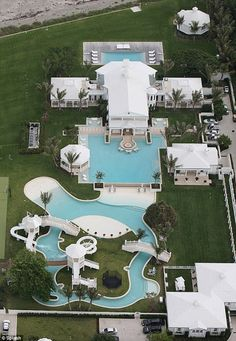 "Now this is a pool! This ""water park"" was designed by Celine Dion for her Florida home and it's pretty impressive. Florida Mansion, Florida Home, Dream Pools, Celebrity Houses, Celebrity Mansions, Cool Pools, Awesome Pools, House Goals, Pool Designs"