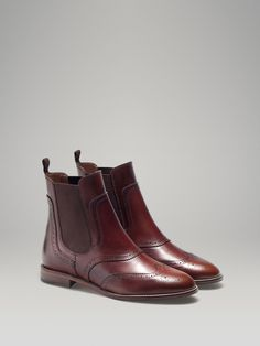 BROWN STRETCH ANKLE BOOT by Massimo Dutti || Natural antik leather ankle boot with brogue detalling, elastic sides, and rear pull tab. Cowhide leather lining and rubber injected leather sole. | $250