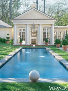 A classic structure sits at the edge of this saltwater pool, providing visitors with the perfect place to relax after taking a dip. See more beautiful backyards. - Veranda.com